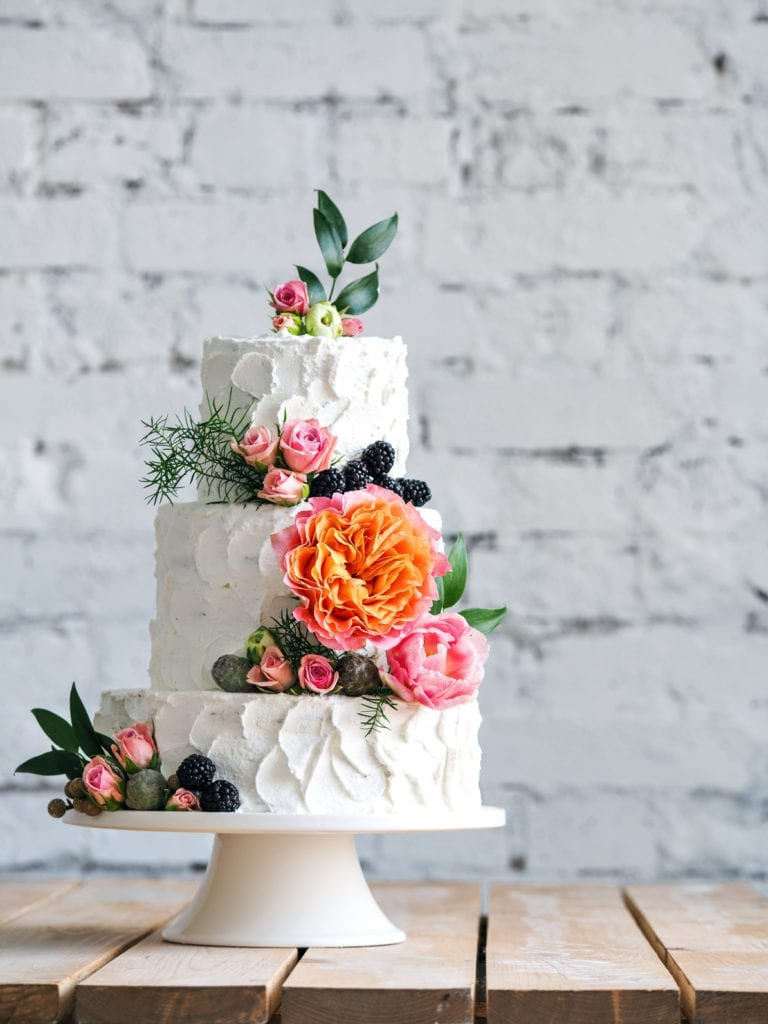 White Wedding Cake With Greenery Roses Flowers
